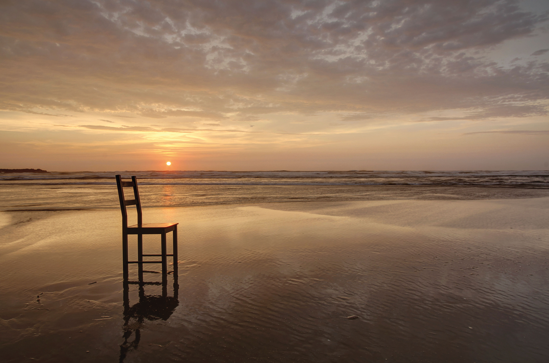 chair in sunset on beach